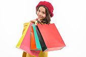 Heavy bags. Small girl with shopping bags. Little shopper. Small child with paper bags. Girl child enjoy shopping. Little shopaholic with paperbags. Shopping is an addiction