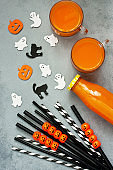 Halloween background with drink in bottle and colorful decorations