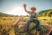 Farmer examinig wheat field status with digital tablet - Senior farmer in wheat field