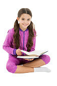 Doing homework. Reading for fun. Literature as hobby. Happy small child read childrens literature. Adorable little girl enjoy reading literature. Learning literature at school. Studying with pleasure
