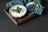 Rice pudding with blueberry decorated with mint leaf