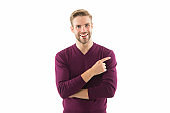 smiling handsome man in cardigan pointing finger. Space for design. Caucasian sexy man. business advertising. male barber care. fashion model isolated on white. Mens Clothing. copy space