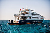 White ship and group of scuba divers, Hurghada, Egypt