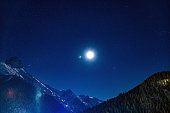 Majestic mountains landscape at night against clear sky with stars