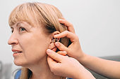 adjusting of a hearing aid for an mature woman