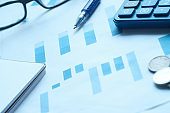 financial charts and office supplies on desk