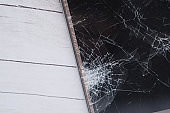 close up of broken and crack smart phone on table