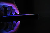 Close up of man hand use smart phone at night