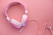 pink color headphone on pink background