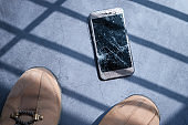 broken and damage smart phone on black table