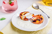 Oven Baked Peaches with Honey and Whipped Cream