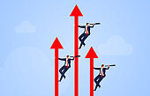 Rising red arrow leads a businessman holding a telescope to observe the distance