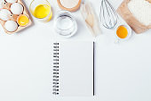 Recipe for homemade bakery, blank notebook next to ingredients