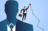 Businessman standing on the shoulders of giants and touching the highest target point