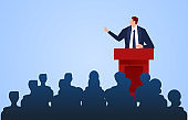 Male businessman standing on the podium making speech report