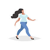 Happy young woman with long black hair walking. Flat modern trendy design style. Urban girl drawing. Wearing t-shirt and skinny jeans. Vector illustration.