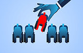 Selection and recruitment, layoffs, a huge hand to choose from sitting among office chairs