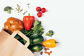 Top view paper shopping bag full of healthy food