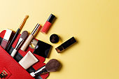 Cosmetics on yellow background