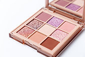 Mua and girly concept. Eyeshadow palette on white background, eye shadows cosmetics product as luxury beauty brand promotion. Fashion blog design. Contouring palette. Makeup palette close up
