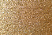 Golden glitter texture. Christmas abstract background. Abstract Bright gold shiny background. Bright halftone pattern. Light paper texture for luxury elegant backdrop design wallpaper or template