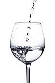 Water is poured into a glass. Splash of water in a wine glass on a white background with bubbles. Studio shot. Water is the basis of life. The concept of a healthy lifestyle