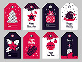 Christmas tags. New Year present and Xmas gift labels with winter holiday decorative elements. Festive tree and poinsettia, balls and hat, candle and wrapped box vector cartoon sticker set