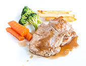 Pork Steak and vegetables on a white background