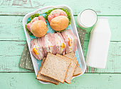 Fresh milk and bread sandwich on wooden table,top view