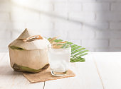 Coconut juice,Drink coconut water on table with shadows from a window frame