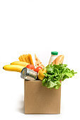 Cardboard box with food isolated on white background.