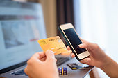 Woman hand is holding credit card, shopping online
