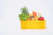 Set of delivery raw food in plastic box on white  background