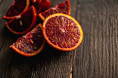 Sweet juicy red oranges on the rustic background