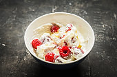 Healthy and tasty breakfast with curd, sour cream, raspberry and honey