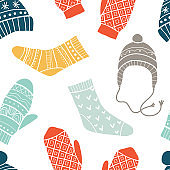 Winter vector seamless pattern with cute socks, hats