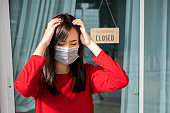 Woman wearing mask closed store with sign board front door shop, Small business come back turning again after the situation is resolved.