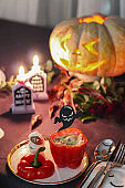 Halloween table with jack o lantern and finger food