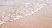 Beach sand and sea coastline. Selective focus.