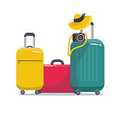 Set of modern suitcase with on wheels for traveling and business trips with camera. Vector. with leaves. isolated on white.