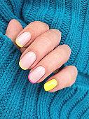 female hand beautiful manicure sweater elegant