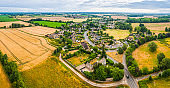 Aerial panorama over country village homes fields farms and pasture