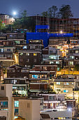 Warmly illuminated homes cosy urban cityscape at night Seoul Korea
