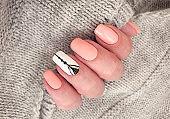 female hand beautiful manicure elegant sweater