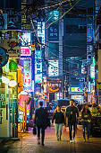 Seoul people on busy nightlife street Sinchon neon night Korea