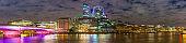 London Bridge River Thames City skyscrapers illuminated night panorama UK