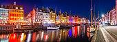 Copenhagen Nyhavn colorful bars restaurants illuminated starry night panorama Denmark