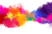Freeze motion of colorful color powder exploding on white background.  Paint Holi.Indian festival Holi