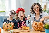 Happy family preparing for Halloween.
