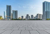 Panoramic skyline and buildings with empty square floor